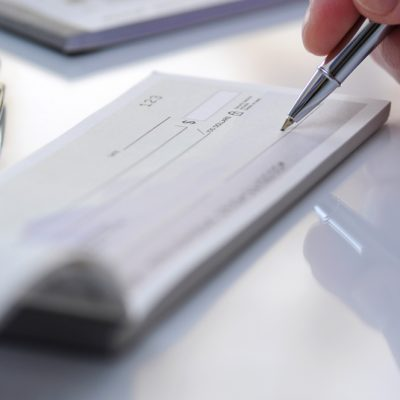 writing a check for charitable giving