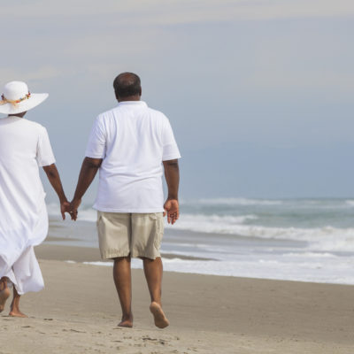 Happy Senior African American Couple Man Woman on Beach