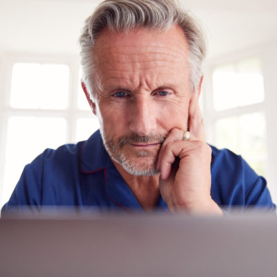mature-man-looking-at-computer-screen