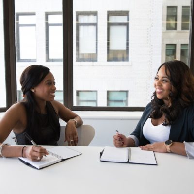 two-black-business-women-in-office