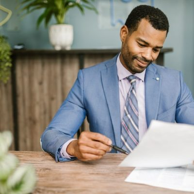african-american-professional-looking-at-paperwork